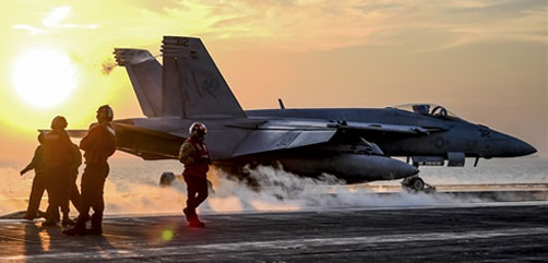 Sailors watch as an F/A-18E Super Hornet launches from the USS Theodore Roosevelt in the Persian Gulf, Feb. 5, 2018. The aircraft carrier is supporting maritime security operations to reassure allies and partners, and preserve the freedom of navigation and free flow of commerce in the region. The Hornet is assigned to Strike Fighter Attack Squadron 113. Navy photo by Petty Officer 3rd Class Spencer Roberts.