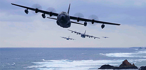 Four Air Force MC-130J Command IIs fly in formation off the coast of Okinawa, Japan, Jan. 6, 2021. - ALLOW IMAGES