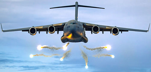 An Air Force C-17 Globemaster III deploys flares as part of a training event over the Atlantic Ocean, June 12, 2021. - ALLOW IMAGES