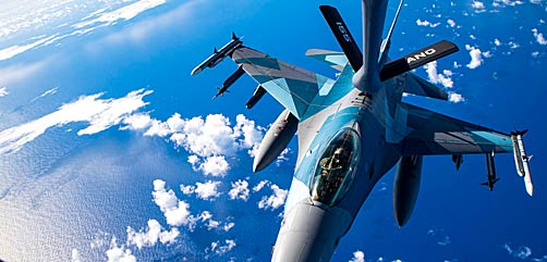 An Air Force F-16 Fighting Falcon conducts an aerial refuel with a KC-135 Stratotanker during Cope North near Andersen Air Force Base, Guam, Feb. 18, 2021. The annual exercise promotes stability and security throughout the Indo-Pacific. - ALLOW IMAGES